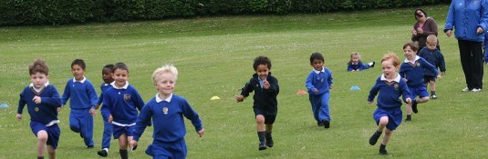 Pre-school-children-outside-running-Essendene-Lodge